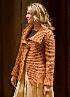 """A cozy fall jacket with an exaggerated collar, Mayer features the same waffle textured stitch used in Faber, from Norah Gaughan vol 5. Shown in size Small Sizes Directions are for women's size X-Small. Changes for sizes Small, Medium, Large, 1X and 2X are in parentheses. Finished Measurements Bust (closed) – 32(36-40-44-48-52)"""" Length – 24½(25-26-26-27-27)"""""""
