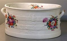 19th century porcelain foot bath painted with flowers