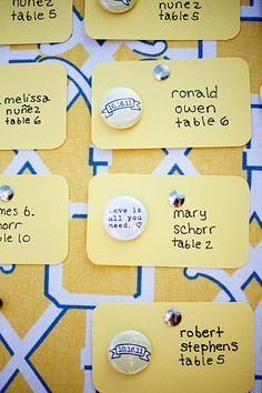 cute idea - place cards with a button favor