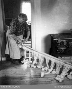 Anne Hansen | beaming the warp | Sámi greneveving: vertical warp-weighted weaving | Manndalen village, northern Norway | 1955 | Marta Hoffman: photographer