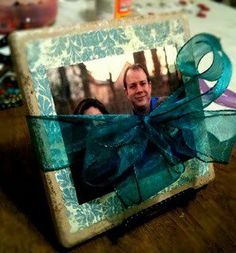 DIY: Pictureframe                                                  Buy a cheap tile from home improvement store. Add a border & then they can put their own picture on it