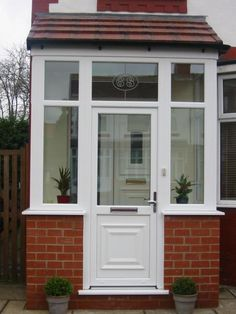 View our large range of standard doors in our gallery. Our standard doors come in an choice of colours and finishes, and come with a 10 year guarantee. Enclosed Front Porches, Front Porch Plants, Front Door Porch, Porch Doors, Small Porches, Front Porch Design, Porch Entry, Glass Front Door, House With Porch