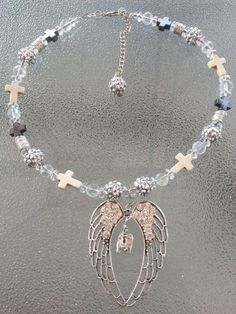 This is a 16 inch choker necklace but it can be made in to any length. Just message me with the length you would like. It has clear glass beads, shiny beads, silver metal beads, stone crosses, black hematite crosses and the angel wing with the guardian angel pendant.