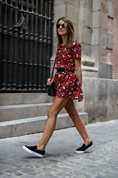 a red printed mini dress with short sleeves and slip ons for a casual look