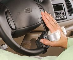 This assistive technology device is an ideal solution for individuals with limited grip strength that have difficulty holding the steering wheel. The device attaches to the wheel and has a cuff that holds the hand in place.