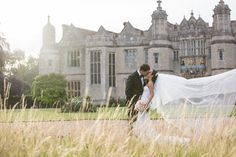 Our stunning bride Charlotte in Inbal Dror outside Hengrave Hall. Photography by http://dottiephotography.co.uk/