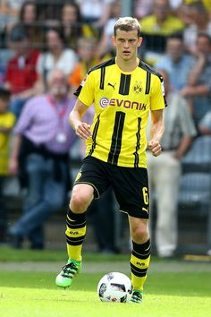 Sven Bender Photos - Sven Bender of Dortmund runs with the ball during the friendly match between Wuppertaler SV and Borussia Dortmund at Stadion Zoo on July 2016 in Wuppertal, Germany. - Wuppertaler SV v Borussia Dortmund - Friendly Match Wuppertaler Sv, Sven Bender, Squad, Twins, Germany, Running, Sports, Photos, Legends