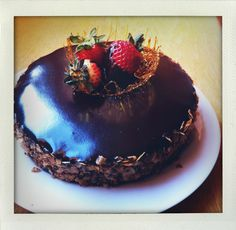 Chocolate Kahlua Cake with Chocolate Coffee Ganache Frosting. Topped with caramel and strawberries.
