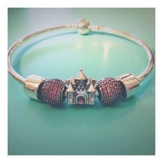 A Pandora bracelet fit for a princess! The clips are the perfect shape on the bangle as the rubber clips underneath hold them in place. Nice