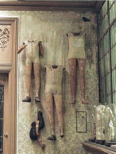 Antique shop mannequins - faded wallpaper