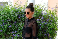 To cool for school. Sheer black shirt, circle shades and cross earrings.