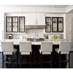 kitchens - white leather stools espresso kitchen island marble countertops marble tiles backsplash polished chrome faucet glass pendants white kitchen cabinets