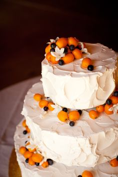 Cake decorated with kumquats and blueberries....pretty.