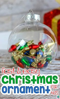 This fast and easy Christmas ornament craft is a perfect kids' Christmas ornament for working on fine motor skills with Christmas light ornaments during your Christmas theme in preschool. This 2-supply Christmas craft is simple enough that every child can enjoy it, but creates a homemade Christmas ornament that kids can give as gifts. #christmasornament #homemadeornament #diychristmas #finemotor #occupationaltherapy