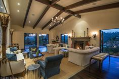 Jennifer Lopezin talo.Beaming smiles:Exposed wooden beams from within the house in the warm living room, afford...