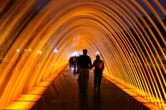 Parque de la Reserva, Peru People walking through one of the 13 illuminated fountains at Lima's Parque de la Reserva