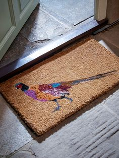 Doormats shouldn't be dull! Our new Pheasant Doormat is as fun as it is functional.  Perfect for the front door, back door or utility room, this fabulous doormat will save your floors from wet or muddy footprints.  Made from hard-wearing coir with colourful pheasant print.