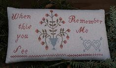 A beautifully crossed stitched early design looking pillow or pinkeep by Susan!