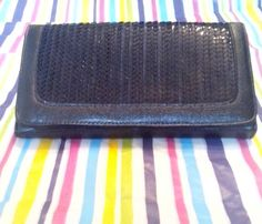 Check out this item in my Etsy shop https://www.etsy.com/listing/173376134/black-sequins-clutch
