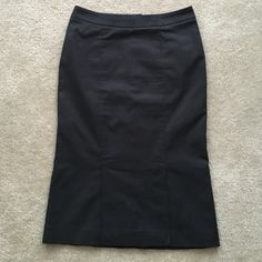 """Pencil Skirt Black pinstriped lined pencil skirt. Back zip and waist snap. Front has a flap as shown in my 3rd pic. 82% cotton, 16% Nylon 2% stretch. Waist measures at 28"""". Length 25. Fits really cute!! I hate to give this skirt up. I held this skirt for some time even though I can fit it no longer .  H&M clothing runs small. H&M Skirts Pencil"""