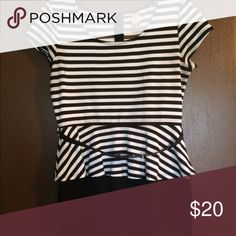 Black and white dress A very cute striped black and white dress that comes with a skinny black belt. The top half is stipend the bottom half is solid black No Boundaries Dresses