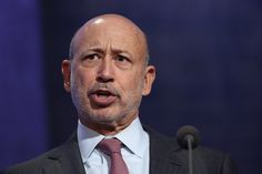 Goldman Sachs reduced the pay of Lloyd Blankfein by $1 million, bringing his pay to $23 million; Morgan Stanley cut the pay of James P. Gorman by $1.5 million to $21 million.