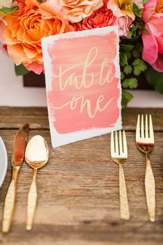 Calligraphy watercolor table number in coral and gold // DIY Watercolour Cards (Instagram: theweddingscoop)