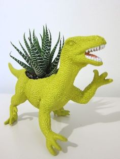 Oh my gosh, so awesome. A velociraptor planter!