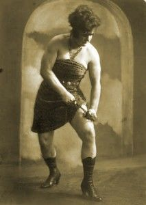 Mighty Sandwina stood over six feet tall and in her heyday was known for her bulging 17 inch biceps and 26 ½ inch thighs. She was initially a wrestler of men and famously offered 100 marks to any man who could best her. According to legend, she never lost her bet and even gained a husband after soundly thrashing a young man by the name of Max Heymann. By his own account he recalled only entering the ring, a blue sky and being carried away by Kate like a prize. They were married for 52 years.