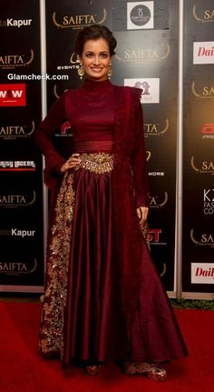 Dia Mirza picked a luxurious winner from Manish Malhotra's Couture 2013 Collection. She sported a maroon anarkali outfit that was styled to look like a lehenga-choli. It had rich gold embroidery on the hips which extended down both sides of the skirt.