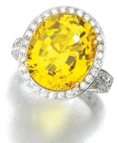 14.32 carat yellow sapphire and diamond ring. Via Sotheby's.
