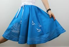 Swing skirt made in 1950s circle skirt design with full embroidery of marine seaside life.   Skirt is made from blue cotton fabric with sateen finish and elastic waist for easy fit. It is fully lined so can be worn during any season.