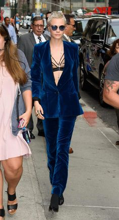 """New Trending Celebrity Looks: Cara Delevingne Wears Head-to-Toe Velvet in Withering Heat, Proving That She's Not Quite Human. """"Valerian and the City of a Thousand Planets"""" star Cara Delevingne heads into the """"Late Show with Stephen Colbert"""" studio in New York.     We are forced to bow down, darlings. The fact that she's mobile under all that velvet (let alone upright); the fact that..."""