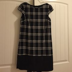 Muse Black and White Plaid Dress Muse dress in size 8 purchased but never worn. Dress comes just above the knee and has a leather like effect to the bottom see in pic 2 Muse Dresses