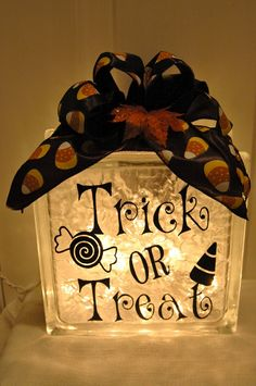 vinyl designs for glass blocks | Trick or treat glass block with vinyl lettering--background lights off