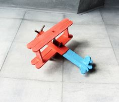 I made this little plane out of lollipop sticks (Popsicle Sticks), It's great fun and these little sticks are strong. The propeller Is made from match sticks. I painted It In these rather nice bright colours, the paints I used for this model  were emulsion paints, a brand called Dulux paints, strong and hard wearing, plus the paints keep their colours for years, good quality paint.