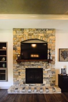 Beautiful Stone Fireplaces a beautiful stone fireplace is added in the home's living room