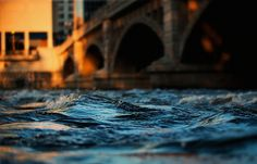Water under a bridge with shallow depth of field