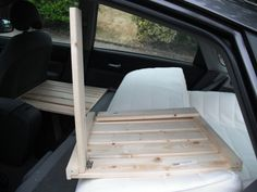 "Prius -  The seat smooshes flatter than it looks once you put your weight on it, but it can be flattened entirely w/ a folded ""egg crate"" foam in the trunk space.  Here's my easy and not-to-spendy mod for people who are afraid of heavy power-tool usage and lacking in the meticulous nature needed to do a fancier set up: 2 Ikea Gorm Shelves: $5 each 2 Ikea Gorm Self Sticks: $2 per pack of 2 4 Hinges/screws for Shelf Sticks 1 Full sized Ikea Sultan Tafjord Memory Foam Pillow Top."