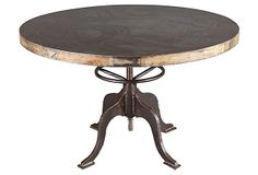 Round industrial steel and reclaimed-wood table with adjustable height. Rotate table clockwise to lift and counterclockwise to drop.