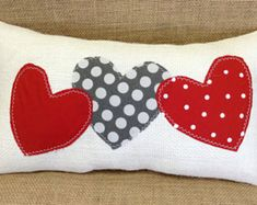 **Please note this item will not ship until AFTER Jan 8, due to an out of state move. This lovely colorful Christmas pillow is a great addition to any holiday decor. It is made with ivory burlap and embellished with three round Christmas balls in reds and greens. This pillow measures approximately 15x8 inches and is fully lined and nicely stuffed with soft polyfill. The ornaments are accented with red jingle bells and coordinating ribbons. There is matching thread that comes down from the…