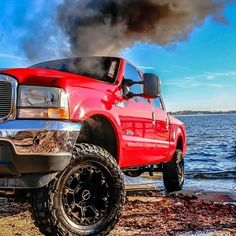 Lifted red ford with smoke stacks!!! I would drive this ford in a heart beat!!!