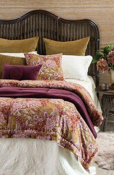 Nativo bedspread with Giardino antique gold comforter and cushion, Mara Fuchsia comforter and cushion and Tramonto eurocases #fuchsia #antiquegold #floral #printedcomforter #bedlinen #decor #rattan #velvetbedding