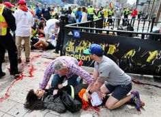 BOSTON 04/15/2013 An injured woman was helped at the scene of the first of two explosions at the Boston Marathon. John Tlumacki/The Boston G...