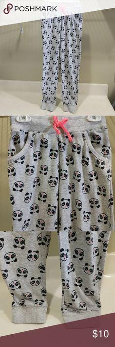 "Girl Panda Sweatpant @tea_n_yoga at Poshmark  Girl panda sweatpants. Good condition. Side pockets. No stain. Elastic waist band.  Measurements flat across - approx. Length - 30.5"" Inseam - 23.5"" Waist - 11"" Bottoms Sweatpants & Joggers"