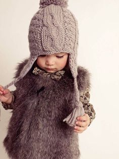 furry vest and cable knit beanie..love this