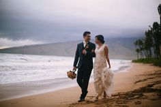 A little post ceremony stroll on the beach. Wedding Coordinator: MB Wedding Design and Events.