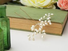 Bud ivory freshwater pearl hair pin. Perfect for tucking in bridal and bridesmaid hair. Handmade to order from Jewellery Made  By Me on Etsy , jewellerymadebyme.etsy.com