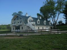 Custom horse barn with powdercoated slider doors | Round Pens ...