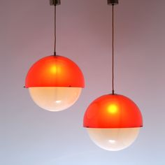 Kartell, light model 4022/5 by Luigi Bandini Buti, Italy 1967 A pair of red methacrylate spherical lamps with opaline white diffusers and chrome-plated brass screws. References: Kartell Catalogue 1970 p.16; Domus n° 456 on p. d/401; Kartell  The Culture of Plastic  Ed. Taschen on p. 110  and in catalogue by Giuliana Gramigna, Repertorio 1950-1980 Ed. Mondadori on p. 228 the free-standing model 4021.